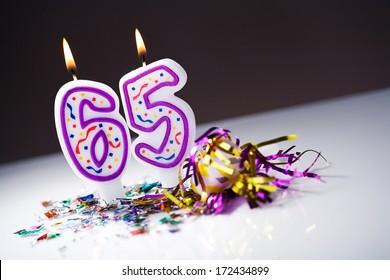 Birthday: Lit 65th Birthday Candles