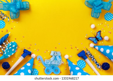 Birthday paper caps with candles  on yellow background,blue baby carriage, hubcaps, bows, whistles, balloon