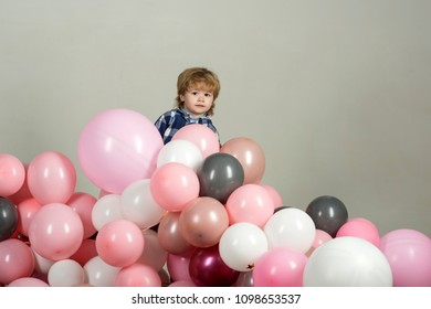 Birthday party. Air balloons for a party. Peekaboo, hide and seek game. Bo peep, hy spy. The child is played and hides behind the balls. Kids toys. Movement and play. Children's activity