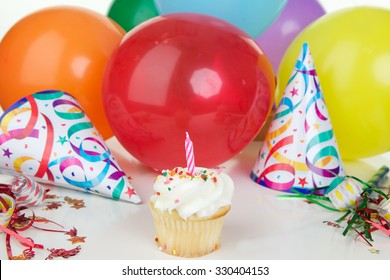 Birthday Party Background with Colorful Balloons, hats and a cupcake