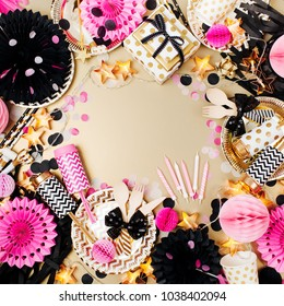 Birthday party background. Gold, black and pink color. Flat lay, top view