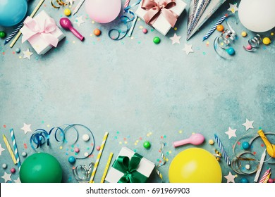 Birthday party banner or background with colorful balloon, gift, carnival cap, confetti, candy and streamer. Flat lay style. Copy space for greeting text.