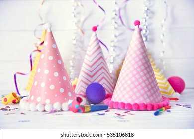 Birthday party caps on wooden background