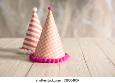 Birthday party caps on wooden table