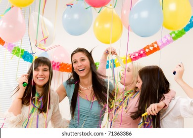 Birthday party celebration - four woman with confetti have fun, toast, dance
