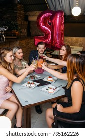 Birthday party celebration. Modern lifestyle. Happy toast, youth company in cafe with drinks. Joyful leisure time, good friends together, festivity concept