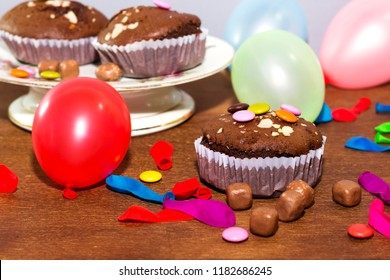 birthday party chocolate arabic homemade cupcake, madeleine with colorful ballons and smarties