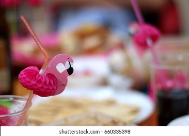 Birthday party with cute pink flamingo straws. Selective focus.