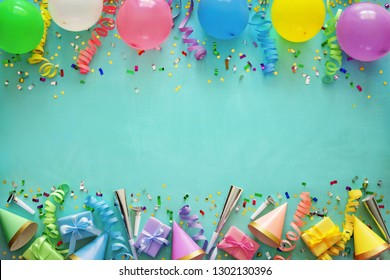 Birthday party decoration with balloons, gift boxes, steamers and confetti