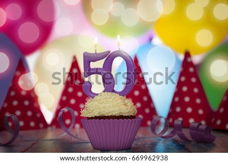 Birthday Party For Fiftieth With Cupcake And Candle