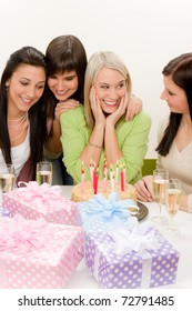 Birthday party - group of woman celebrate with cake and champagne