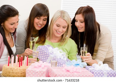 Birthday party - happy woman getting present, champagne, cake