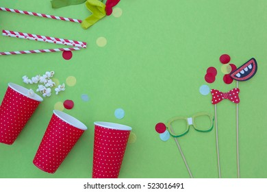 birthday, party items in a green background.Overhead shot