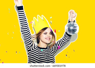 Birthday party, new year carnival. Young smiling woman on white background celebrating brightful event, wears fashion striped dress and yellow crown. Sparkling confetti, having fun, dancing