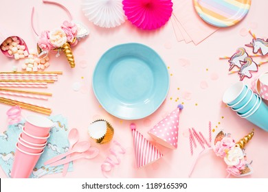 Birthday party in unicorn theme on pink flat lay.