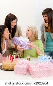 Birthday party - woman getting present with champagne and cake