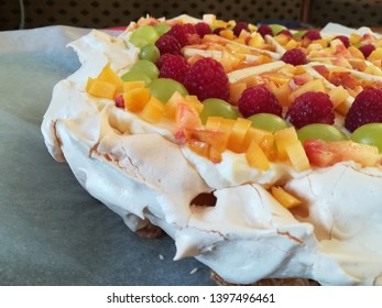 Birthday pavlova cake with various fruits.