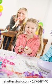 Birthday: Smiling Little Girl At Party