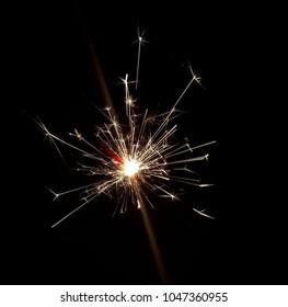 Birthday squib burning in the dark.