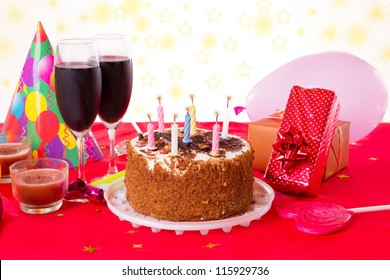 Birthday Table With Cake Candles Wine And Gifts