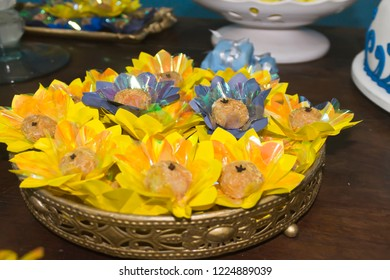 Birthday table decorated with trays of coconut candies and Indian carnation