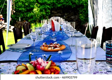 Birthday table in our garden before the arrival of guests. Focus is on the plate with canapes.  /  Birthday table