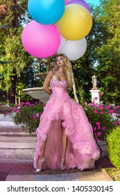 Birthday and wedding girl. Happy young woman with colorful latex balloons, outdoor. Trendy wedding style shot in full length. Young attractive caucasian blonde model like a bride - Image