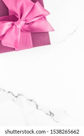 Birthday, wedding and girly branding concept - Pink gift box with silk bow on marble background, girl baby shower present and glamour fashion gift for luxury beauty brand, holiday flatlay art design