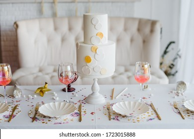 Birthday or wedding table setting in white colors with cocktails in glasses. Baby shower or girl party. Selective focus