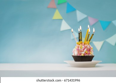 Birthday white cake with colorful candles in vintage color