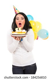 Birthday woman blowing cake candles isolated on white background