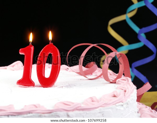 Birthday-anniversary cake with red candle showing Nr. 10