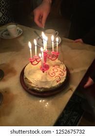 Birthdaycake. Candles burning. Celebration. Christmas. Homemade