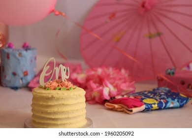 Birthdaycake shoot, decorated with loads of pink accessories and loads of baby gits