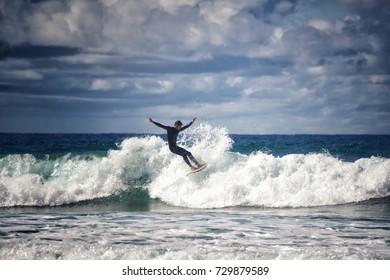 BISCAROSSE, FRANCE - SEPTEMBER 15, 2017: Surfer boy riding the waves in the Atlantic ocean, Biscarosse, France.