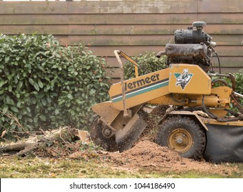 Biscarrosse/France March 1, 2018: stump grinder to wear stump down below ground level with fast spinning blade