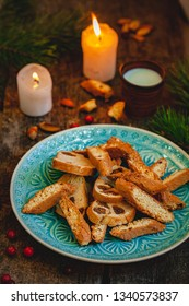 Biscotti or cantucci with milk on wooden rustic table. Close up. Christmas food concept