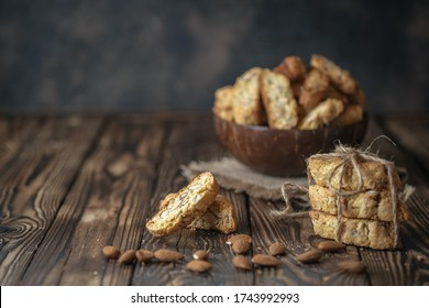Biscotti cantuccini cookies and almonds on a rustic background with copy space.