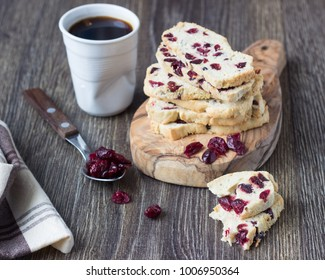 Biscotti or Cantuccini with cranberry  and a cup of coffee. Traditional Italian double baked cookies