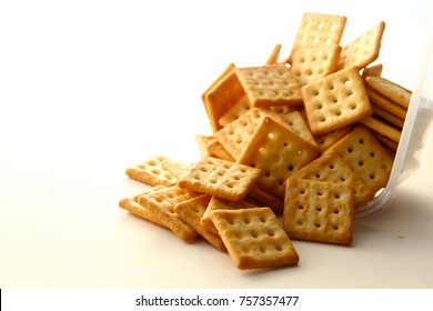 Biscuit background / Biscuit is a variety of quick bread made from ingredients like flour, leavening, shortening, and milk or water. Crackers are types of biscuits which are neutral