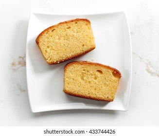 biscuit cake slices on white plate, top view