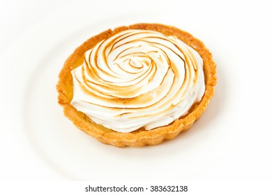 Biscuit with cream, isolated on white plate