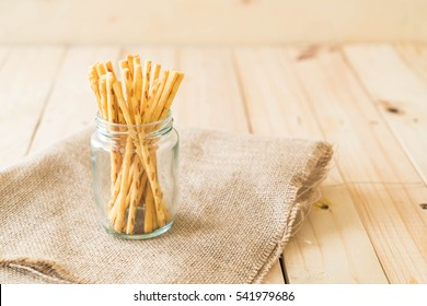 biscuit stick on wood background
