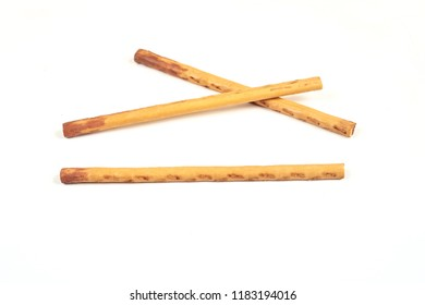 biscuit sticks with sweet filling on white background.