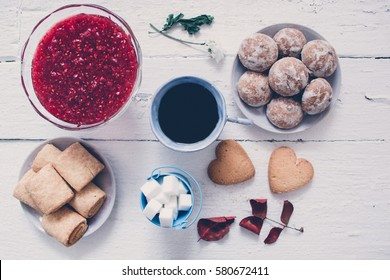 Biscuit sugar, jam cup of coffee on the wooden