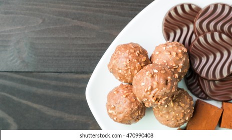 Biscuits and chocolate on white plate