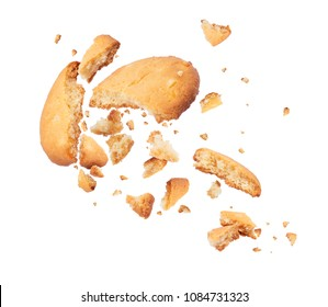 Biscuits crumbles into pieces close-up isolated on a white background