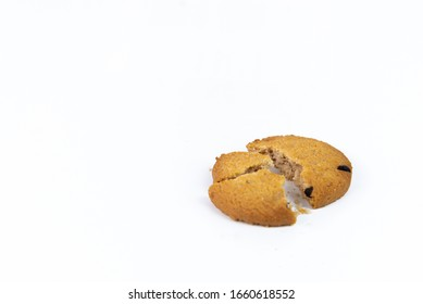 Biscuits crumbles into pieces or oatmeal cookies isolated on a white background.