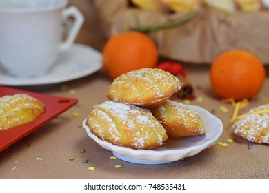 Biscuits Madeleine with orange, dusted with sugar powder. Christmas and New Year concept