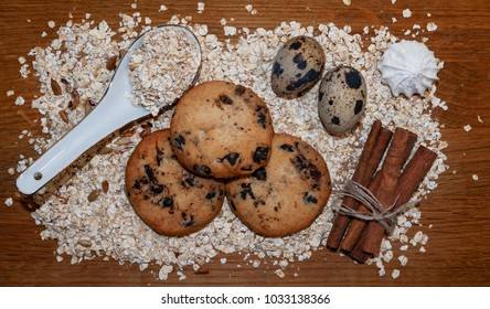 biscuits, oats flakes, cinnamon sticks, meringue, eggs on a wooden table